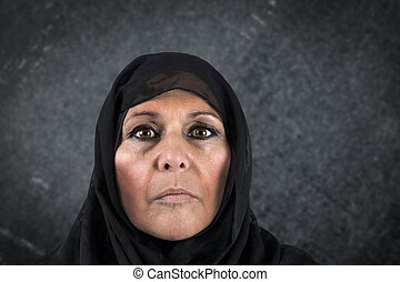 Dramatic muslim woman - Dramatic portrait of serious middle...
