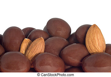 chocolate covered almonds and almonds isolated on white...
