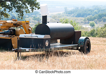 Smoker grill on a farm - Smoker grill on a camo trailer out...