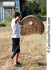 Teen boy bow hunting - Cute teenage boy shooting a boy...