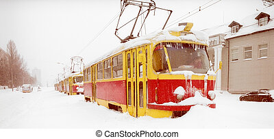 After snowstorm in the city. - Streetcars in the street...