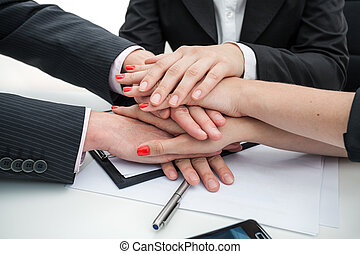 Business team- hands - Closeup of a business people hands -...