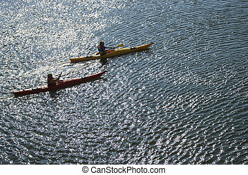 Boys sea kayaking - Aerial of two teenage boys kayaking on...