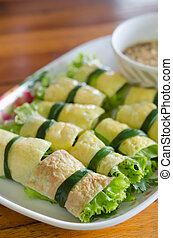 Vietnames style food - close up fried egg rolled with fresh...