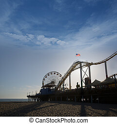 Santa Moica pier Ferris Wheel at sunset in California USA