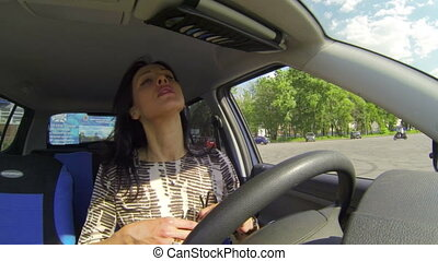 Brunette in the car moves makeup