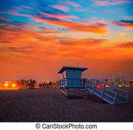 Santa Monica California sunset lifeguard tower and glowing...