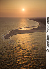 Beach at sunset - Aerial view of sun over Atlantic ocean and...