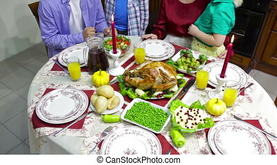 Family at table - Family of four being at the table served...