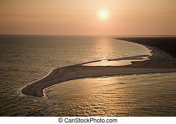 Beach in sunset. - Aerial view of sun over Atlantic ocean...