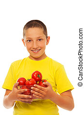 Boy and tomatoes - Portrait of happy young boy with bunch of...