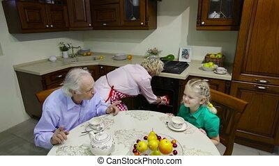 Tea at grannyu2019s - Cute children having a tea with their...