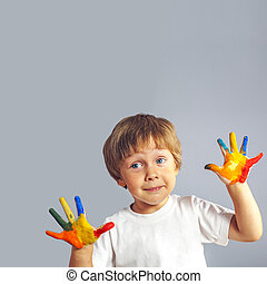 boy with hands painted in colorful paints - Little boy with...