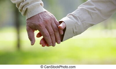 Hold my hand - Close-up of an elderly couple holding hands...