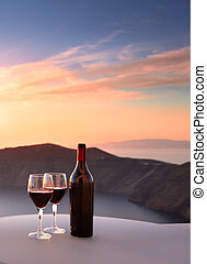 Santorini Wine - Wine bottle and glasses overlooking...
