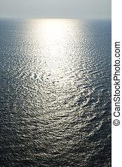 Sun on ocean. - Sun reflecting off Atlantic ocean.