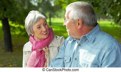 Seniors outdoors - Retired couple spending time together...