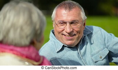 Laughing - Optimistic elderly couple being outdoors, man...