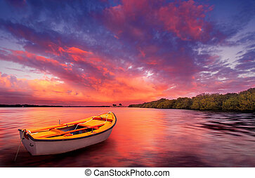 Alone in Colour - A rowboat watches an amazing sunset