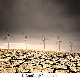 Doomed - Windfarm in a barren cracked desert