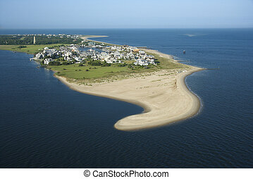 Coastal community. - Aerial view of beach and residential...