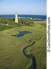Lighthouse in marsh - Aerial view of Old Baldy lighthouse in...