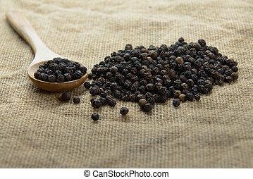 Black pepper - Close-up image of black pepper over gunny bag