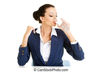 Business woman drinking mineral water