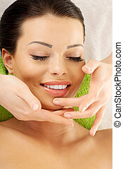 Beautiful relaxed woman enjoy receiving face massage -...
