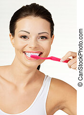 Woman holding tooth brush, isolated - Woman with great teeth...