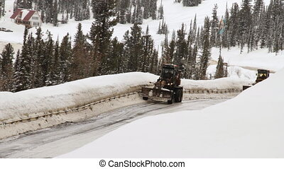 Winter road. Cleaning the snow on the road.