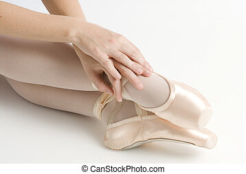 hands and feet - dancer in ballet shoes dancing in pointe
