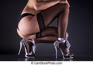 sexy naked woman showing butt with High Heels
