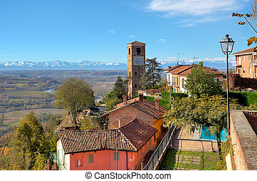 Small town and old belfry in Italy. - View of small town and...