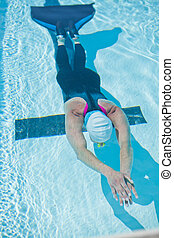 Female freediver in pool - Female freediver with monofin...