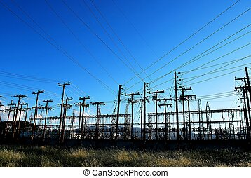 Electricity posts - Many wooden electricity posts at a power...