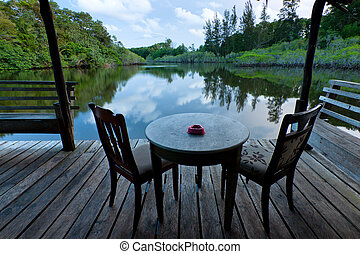 table and chairs with lake view