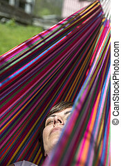 Woman in a hammock - Woman relax in a hammock