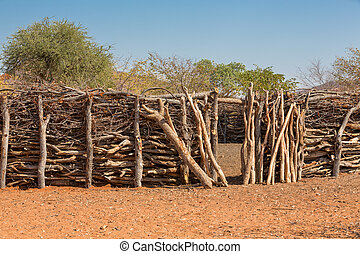 Traditional huts of himba people - Closeup of entrance of...