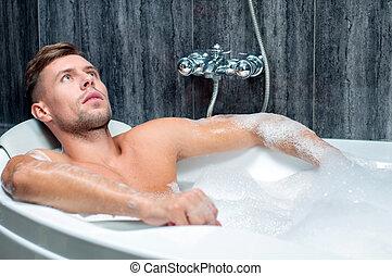 taking bath - Young muscular man taking bath