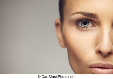 Young woman half face closeup - Close-up portrait of pretty...