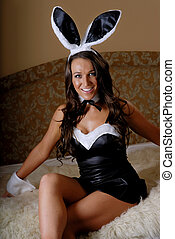 Brunette bunny girl - Pretty girl in bunny outfit.