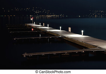 Port on the lake at night - Empty harbor on the water at...