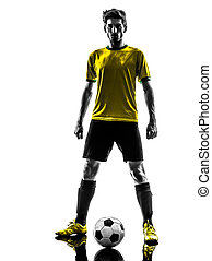 one brazilian soccer football player young man standing defiance  in silhouette studio  on white background