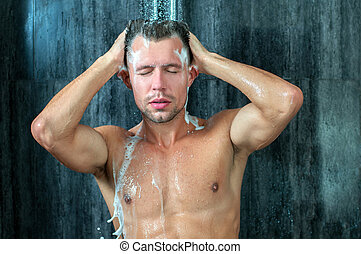 Shower - Close-up of a young man taking a shower