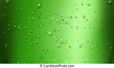 green apple juice - the bubbles floating up in the liquid of...