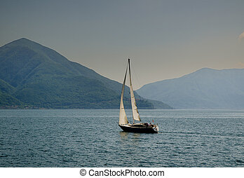 Sailing boat on a lake with mountains