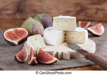 Camembert and figs - Camembert and fresh figs on a cutting...