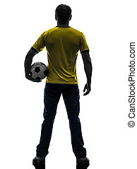 rear view back man holding soccer football silhouette
