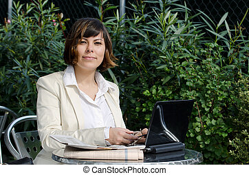 Business woman sitting down with her personal computer and...